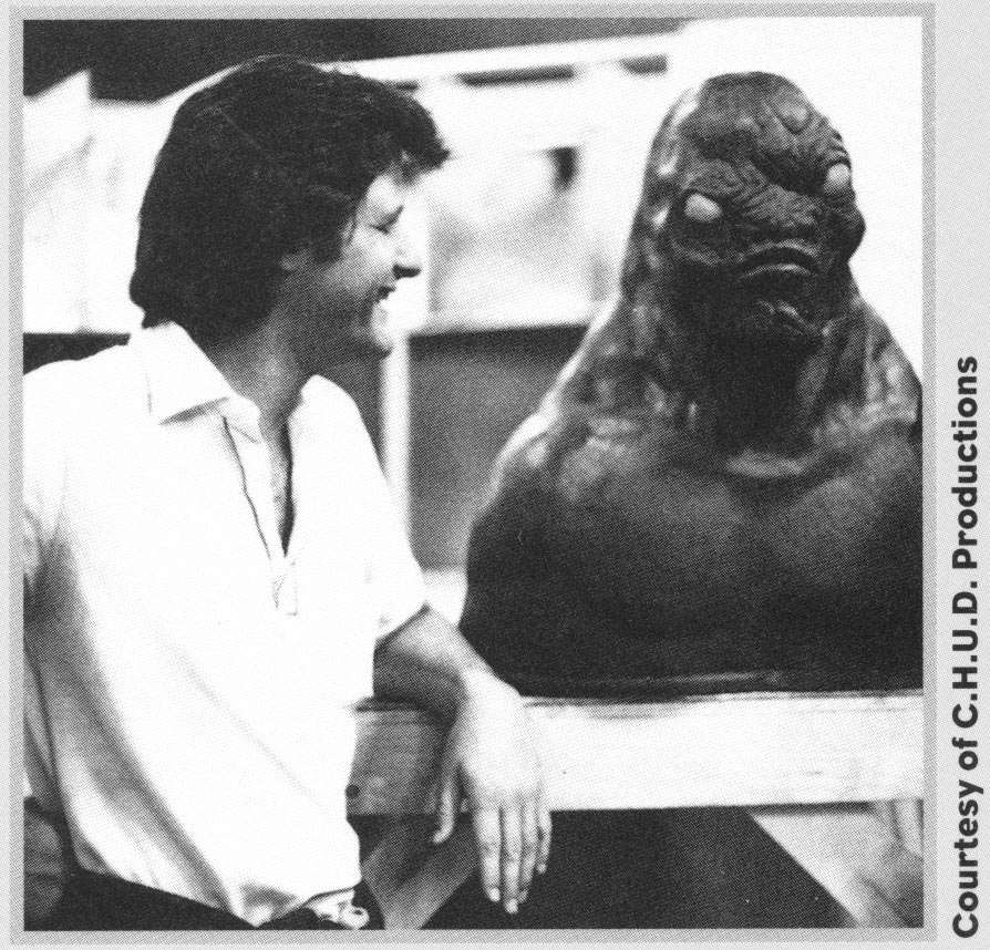 Author/screenwriter inspects a monster head on the set of the movie C.H.U.D.